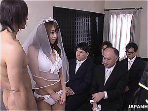 asian bride deepthroating rod during her wedding