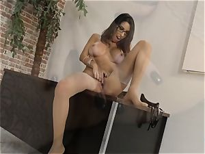 Dava Foxx conversing messy while using her mitts on a wood