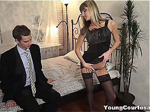 She puts on her sexiest garb to keep him glad