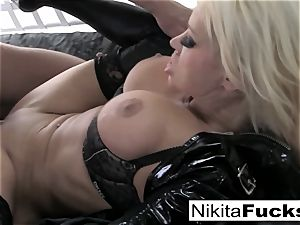 huge-chested Nikita nails a gigantic spear