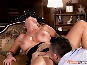 naughty Nikki Benz drinks down a gigantic penis