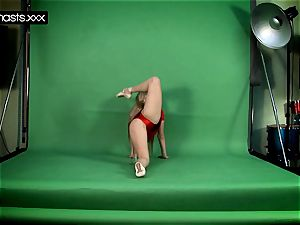 red clad Gymnast Doing stretches