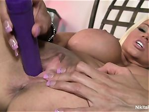 super-steamy blond Nikita plays with a purple fucktoy