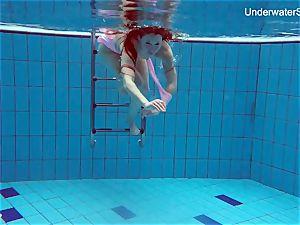 sandy-haired Simonna demonstrating her assets underwater